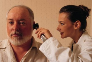 auditory system: doctor examining a patient